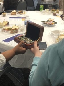Passing Paul's championship ring box around the table